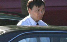Dr. Huong Luu of Vancouver, Wash., shown here in a white shirt and tie, was allowed to keep his license despite secretly taking pictures of dozens of female patients' genitalia.