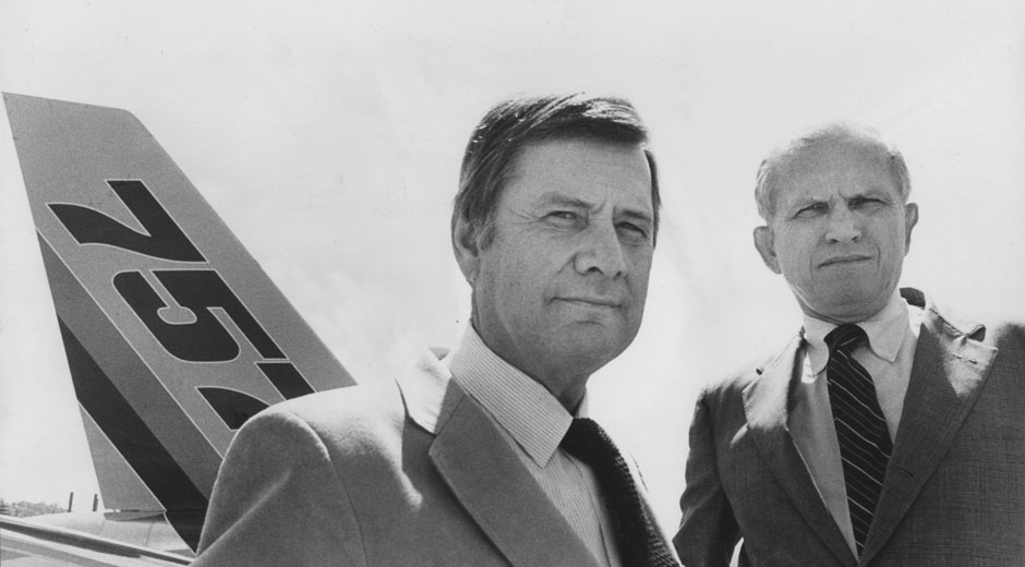 In 1978 Tex Boullioun, left, president of the Boeing Commercial Airplane Co., agreed to Eastern Airlines President Frank Borman's request for a larger, more fuel-efficient jetliner. Their handshake deal launched Boeing on a crash multi-billion-dollar development program characteristic of this 'sporting business that rivals Las Vegas.'