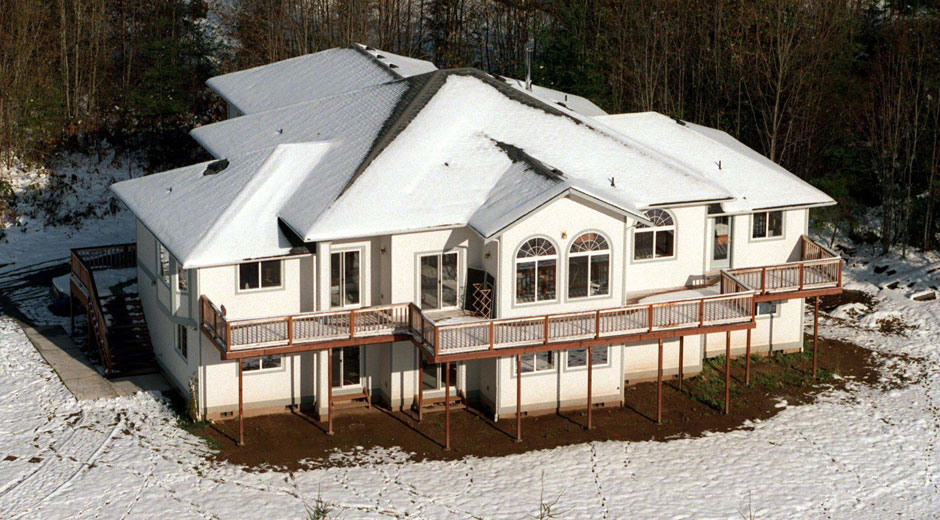 A 5,300-square-foot white house sits on a thin blanket of snow amidst the woods on the Tulalip Indian Reservation, north of Everett. The house was built with taxpayer money earmarked for low-income housing.